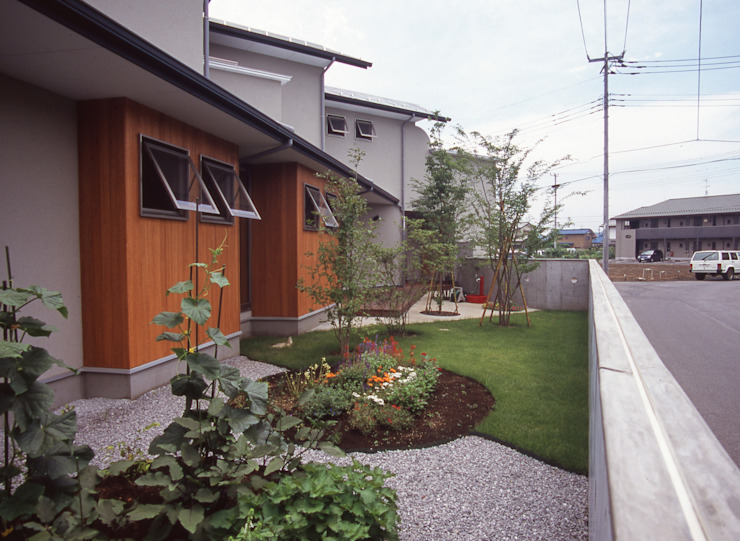 Eclectic style garden by (株)独楽蔵 KOMAGURA Eclectic