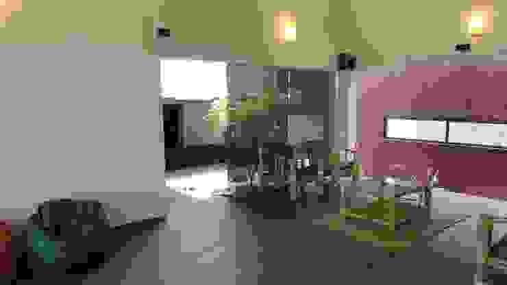 gandhi farm house 4th axis design studio Rustic style living room