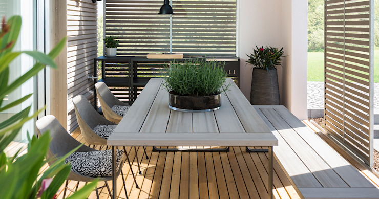 Modern terrace by Bau-Fritz GmbH & Co. KG Modern