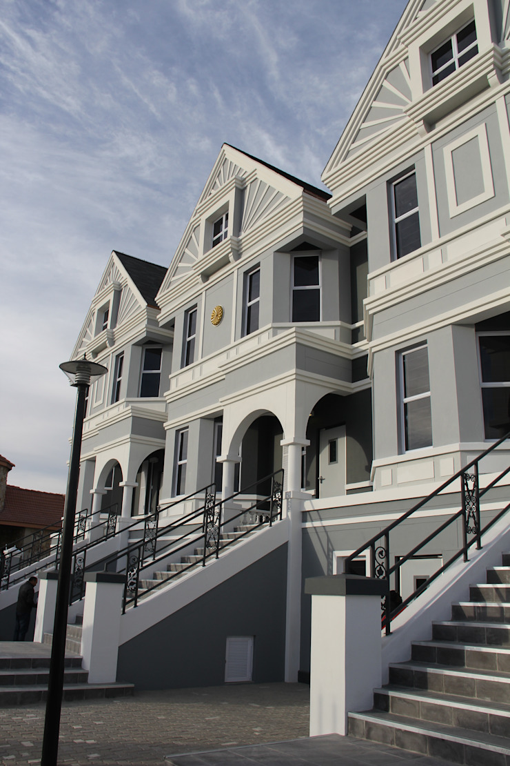 Painted ladies – New office building – Namibia. Classic style houses by Nuclei Lifestyle Design Classic