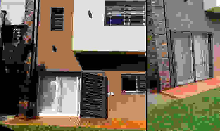 Fachada Casas modernas: Ideas, imágenes y decoración de MONARQ ESTUDIO Moderno Piedra