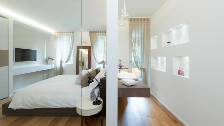 غرفة نوم تنفيذ Studio Associato Casiraghi , تبسيطي