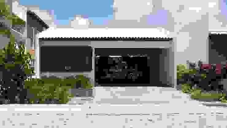 房子 by Coletivo de Arquitetos, 簡約風