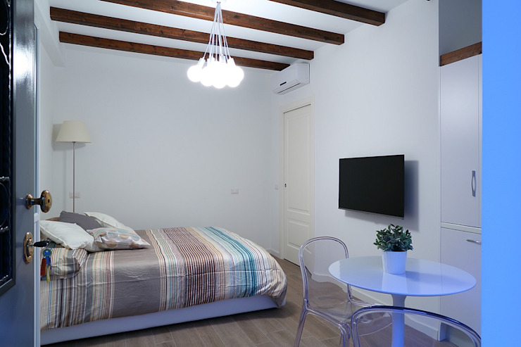 Minicucine a scomparsa con ante cm.125 - stanza di SIZEDESIGN SMART KITCHENS & LIVING Moderno