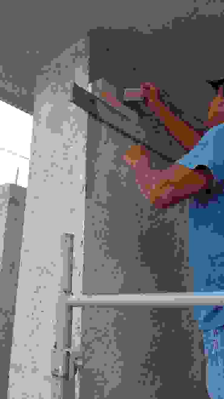 Colocación de piedrin, recubrimiento de muro columna con piedra, pieza por pieza de RecreARQ Construcciones