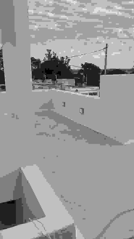 Detalle luminarios en terraza de RecreARQ Construcciones