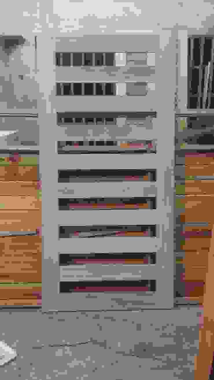 Fabricación de puerta principal de RecreARQ Construcciones