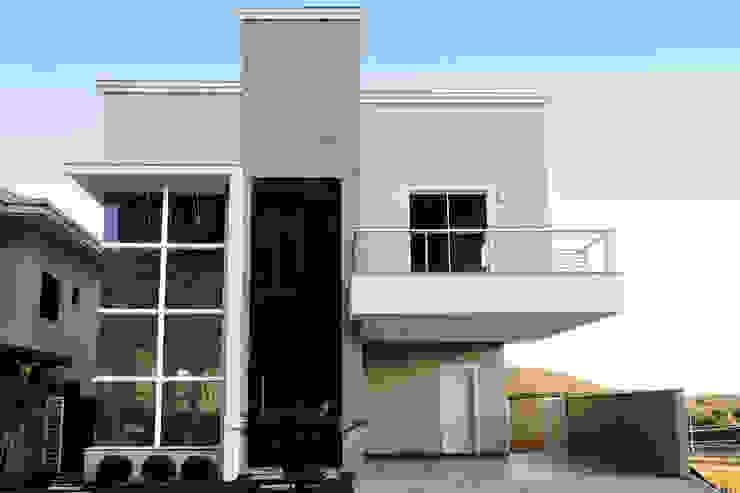 Modern Houses by Cecyn Arquitetura + Design Modern