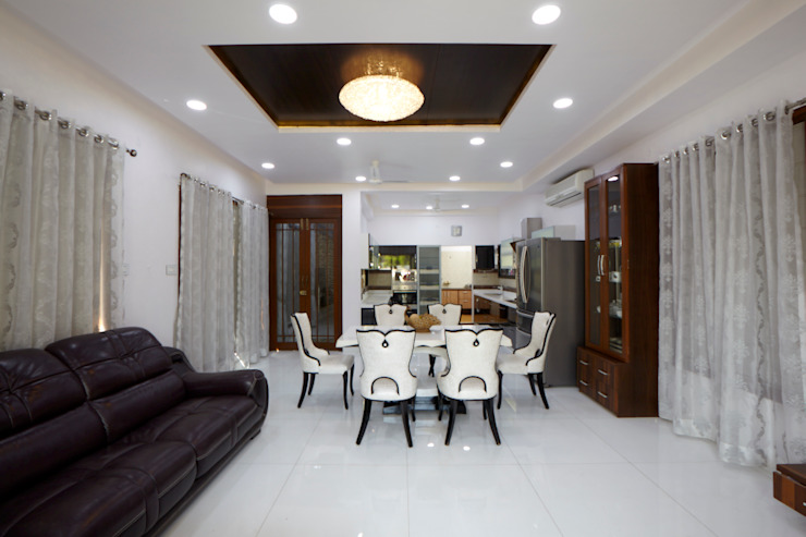 Dr Rafique Mawani's Residence Minimalist dining room by M B M architects Minimalist