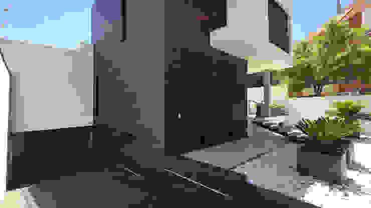 Casas modernas por arqubo arquitectos Moderno Cerâmica