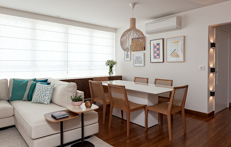 Dining room by Ambienta Arquitetura ,