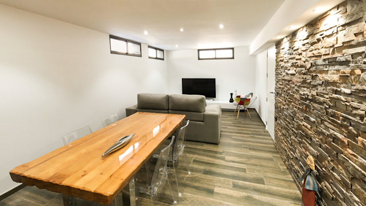 Living room by arqubo arquitectos, Modern Stone