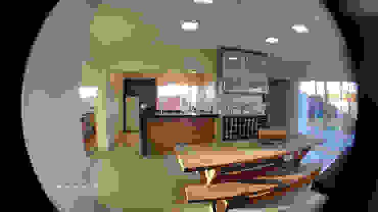 Cozinha e área gourmet por Monteiro arquitetura e interiores Moderno