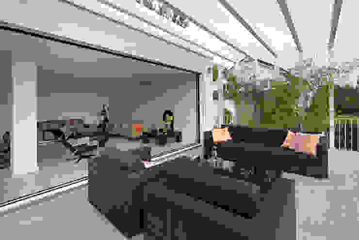 Modern terrace by LABOR WELTENBAU ARCHITEKTUR Modern