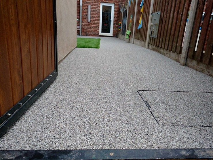 Rear garden gets a make over using resin bound paving Permeable Paving Solutions UK Classic style gym Granite Grey