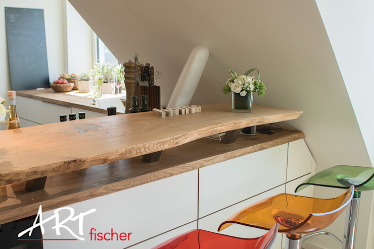 Modern kitchen by ARTfischer Die Möbelmanufaktur. Modern Wood Wood effect
