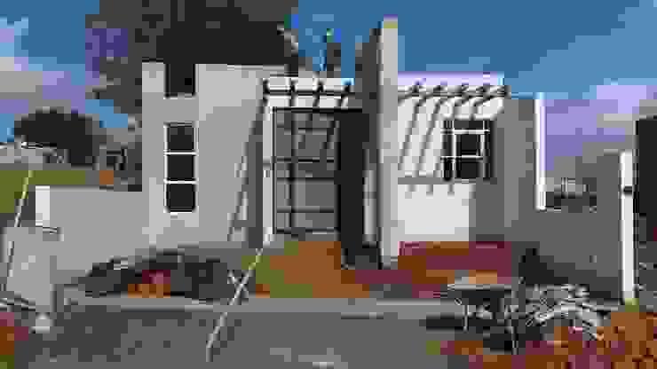 FACHADA Casas modernas de GNG ARQUITECTURA Y DISEÑO Moderno Ladrillos