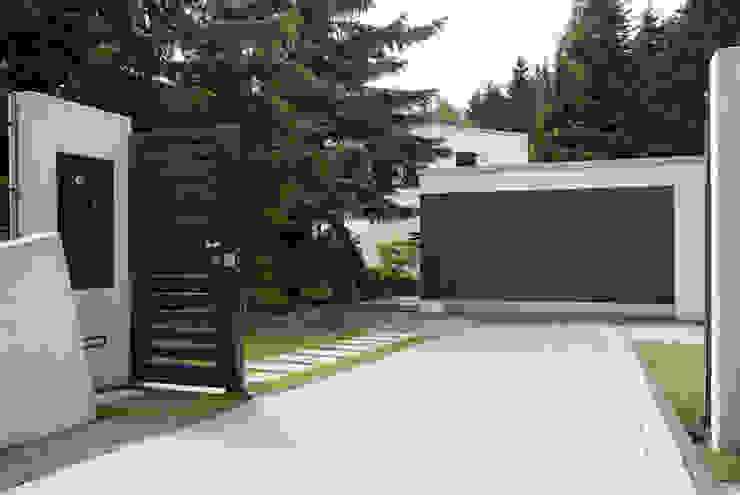 fried.A - Büro für Architektur Garajes y galpones de estilo moderno