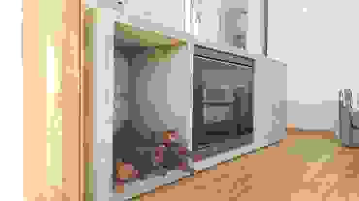 Salas de estar modernas por estudio|44 Moderno Betão
