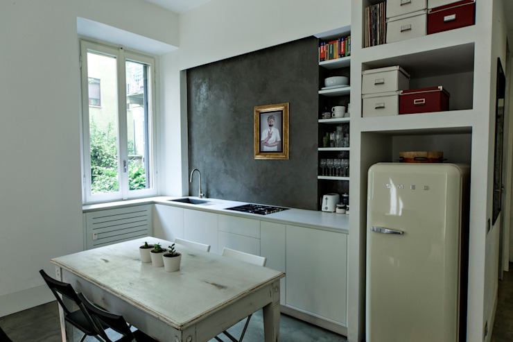 pranzo vintage Sala da pranzo minimalista di studio ferlazzo natoli Minimalista