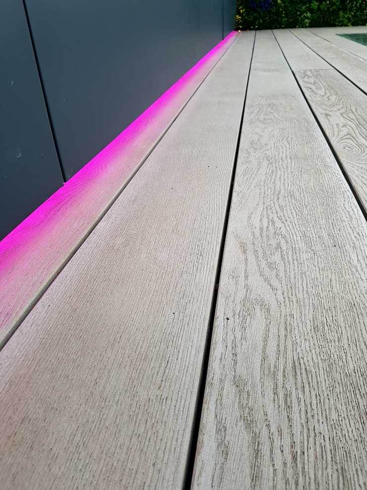 Enhanced grain Smoked Oak Millboard decking with LED lighting strip Modern balcony, veranda & terrace by Paul Newman Landscapes Modern