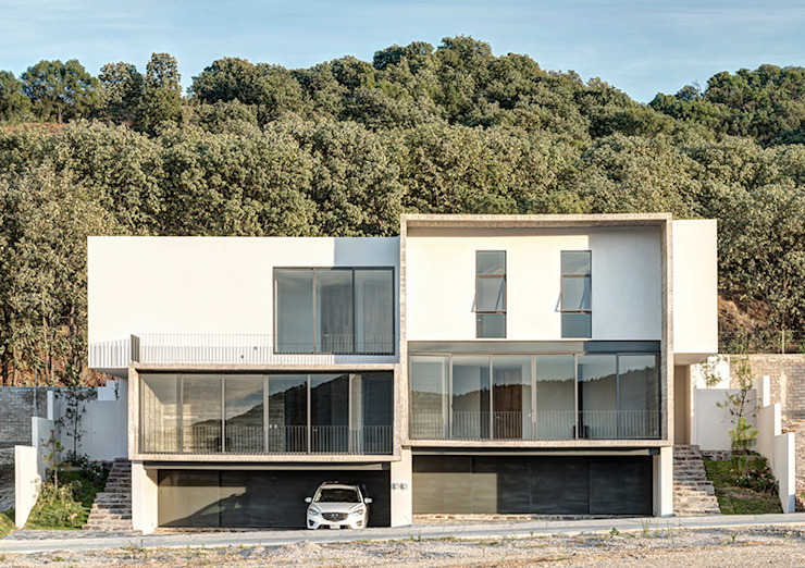 Casas de estilo minimalista de La Desarrolladora Minimalista Hormigón