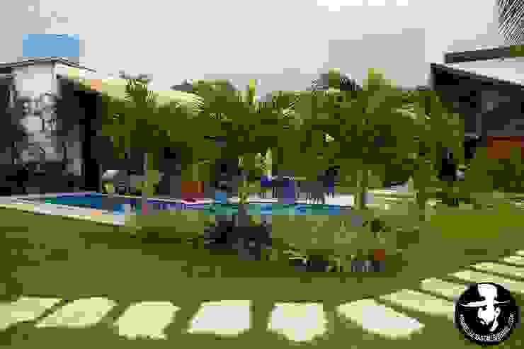 Tropical style garden by Tânia Póvoa Arquitetura e Decoração Tropical Marble