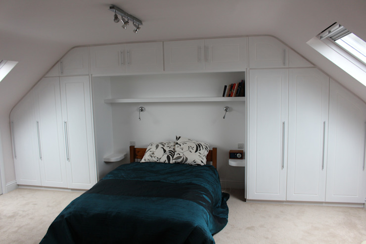 A wall of fitted wardrobes TreeSaurus BedroomWardrobes & closets MDF White