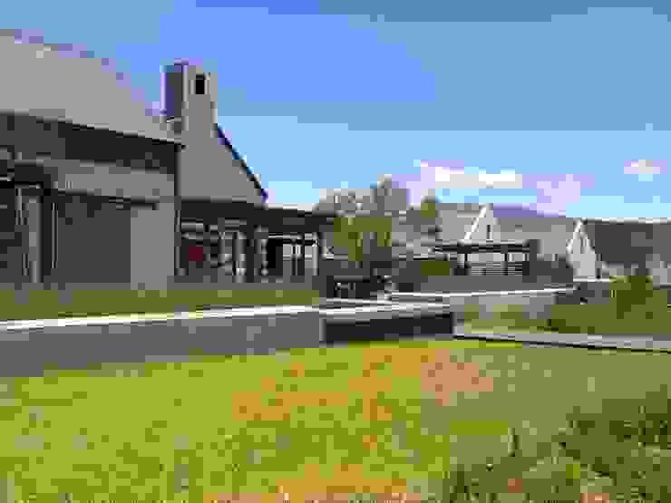 Modern Farmhouse in Franschhoek Modern Garden by Red Daffodil Modern