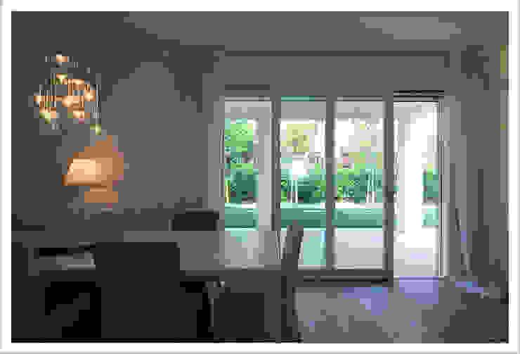 Modern dining room by ALDENA Modern