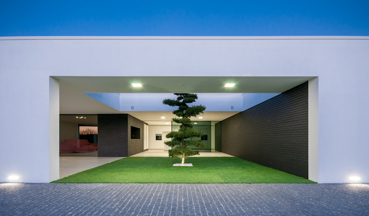 Сад в стиле модерн от ARTEQUITECTOS Модерн