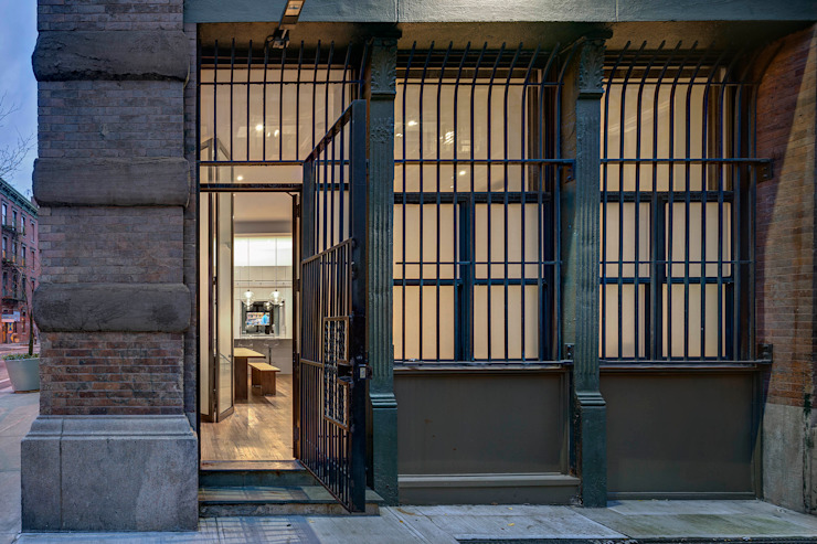 Exterior of Duplex At Street Entry Level Industrial style houses by Lilian H. Weinreich Architects Industrial Bricks