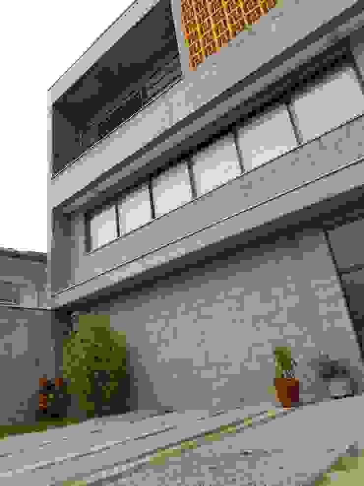 Metamorfose Arquitetura e Urbanismo Casas de estilo rústico Concreto