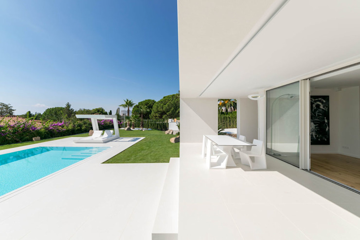 Herrero House Varandas, marquises e terraços mediterrânicos por 08023 Architects Mediterrânico
