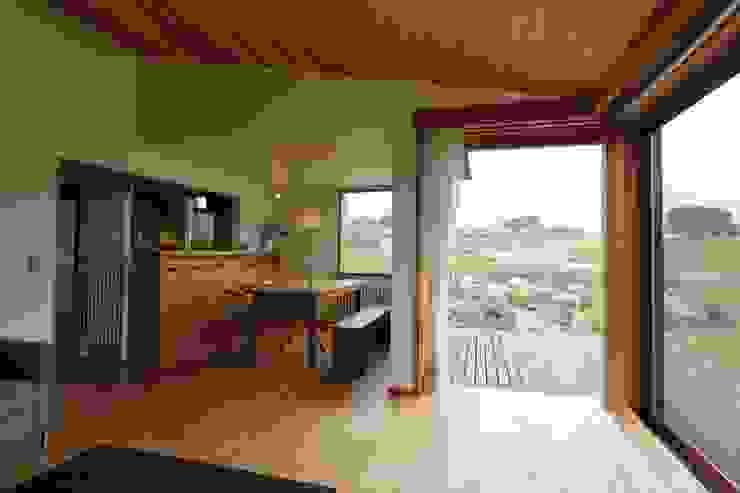 Comedor de estilo  de 藤松建築設計室,