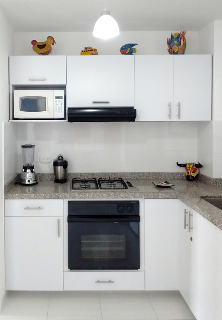 Área de cocción Cocinas modernas de Remodelar Proyectos Integrales Moderno Tablero DM