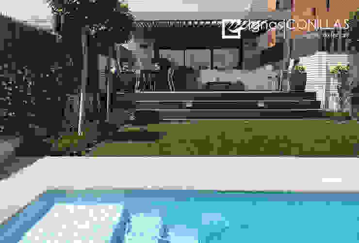 Family garden CONILLAS - exteriors Jardines de estilo moderno
