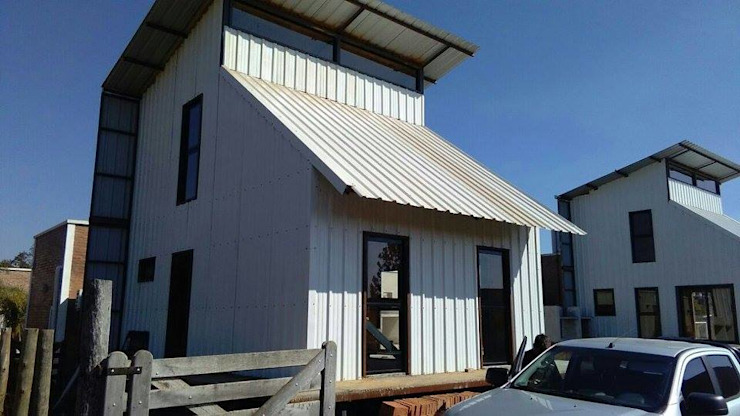 CABAÑAS PRE-FABRICADAS Casas modernas: Ideas, imágenes y decoración de FILIPPIS/DIP - DISEÑO Y CONSTRUCCION Moderno Metal