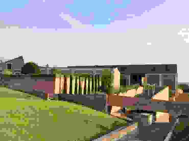 Recupero e restauro del sito di archeologia industriale EX FONDERIE BALLARINI (SASSUOLO – MODENA) Architetto Silvia Giacobazzi Case in stile industriale