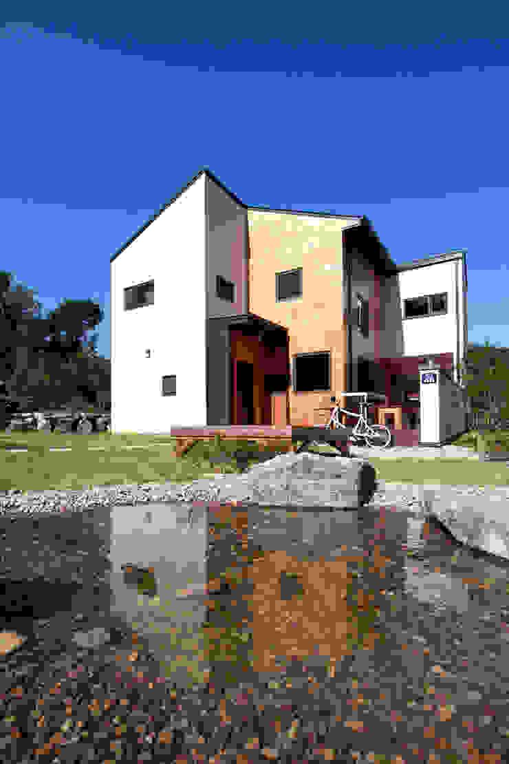 주간전경 모던스타일 주택 by 주택설계전문 디자인그룹 홈스타일토토 모던 우드 우드 그레인