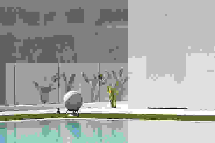 MORADIA MONTE ESTORIL Piscinas modernas por fernando piçarra fotografia Moderno