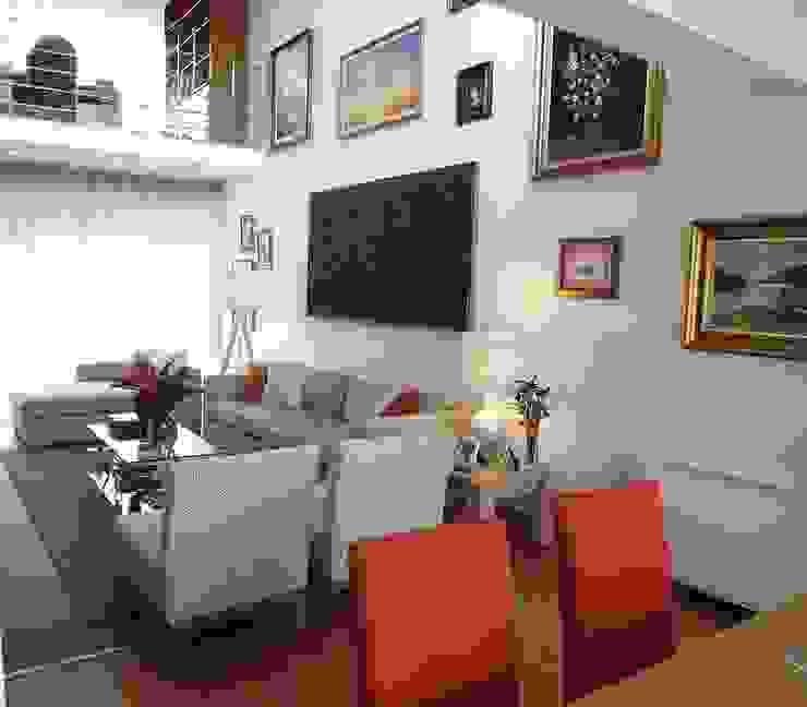 Sala - Vista da zona de refeição por Traço Magenta - Design de Interiores Moderno