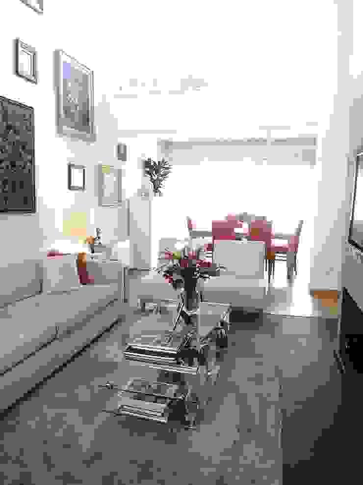 Sala - Zona de TV por Traço Magenta - Design de Interiores Moderno
