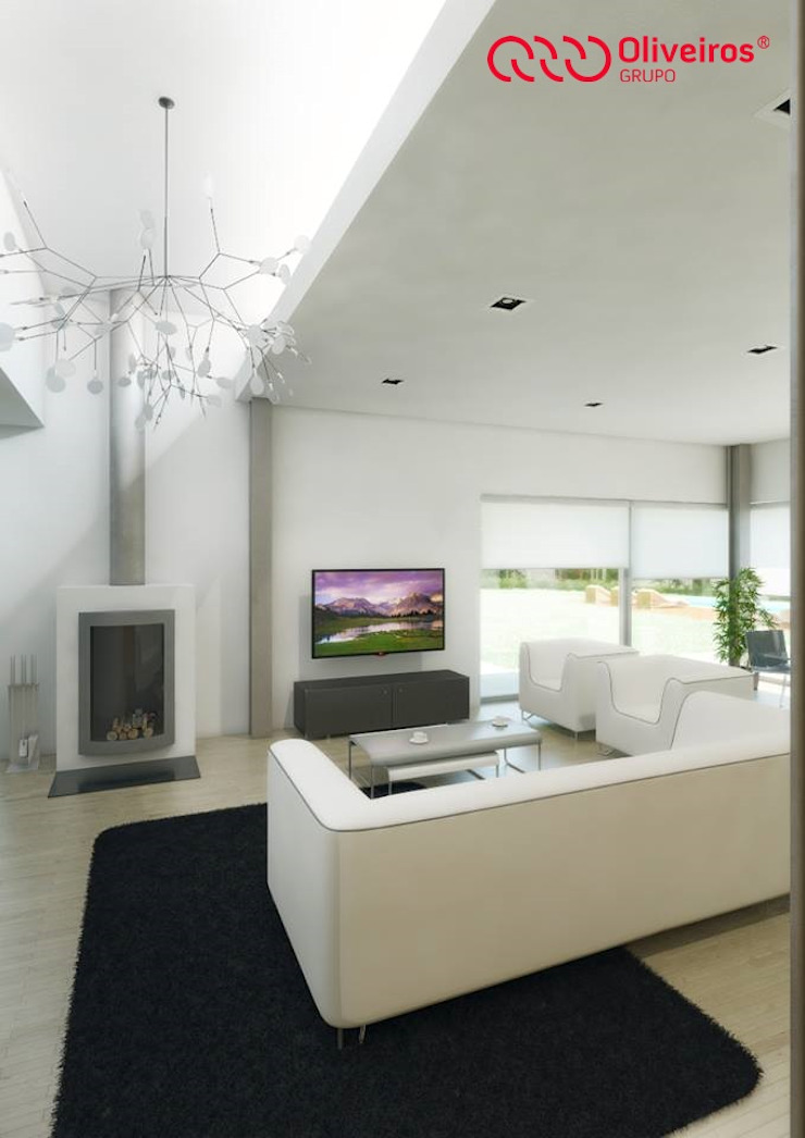 Modern living room by Oliveiros Grupo Modern
