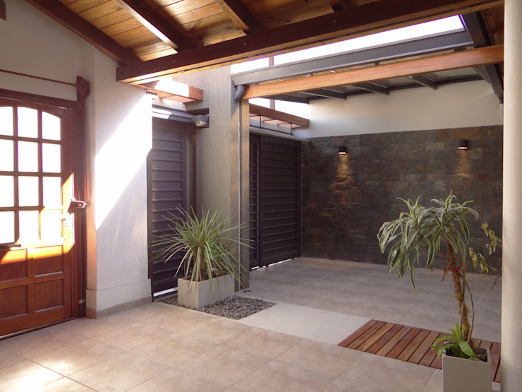Casas de estilo  por D'ODORICO ARQUITECTURA,