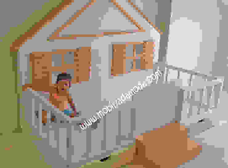 Детская комната в стиле модерн от MOBİLYADA MODA Модерн Дерево Эффект древесины