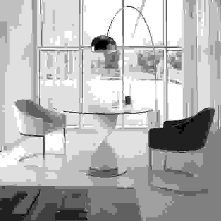 Mesa redonda com design moderno Round table with modern design por Intense mobiliário e interiores; Moderno