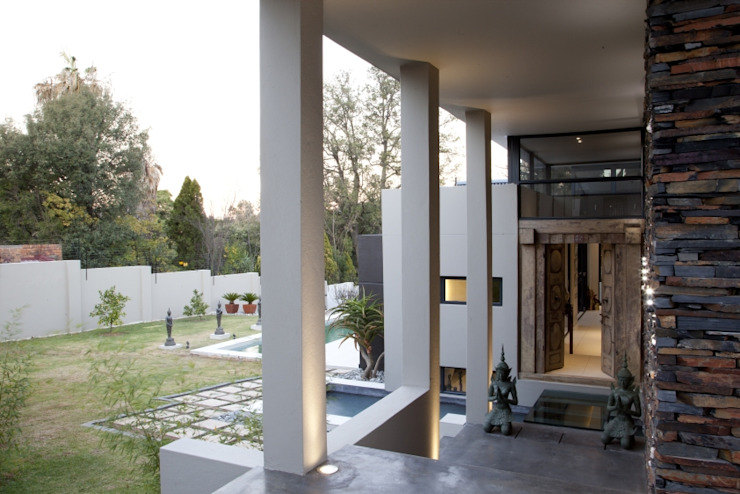 Entrance colonnade by Spiro Couyadis Architects Modern