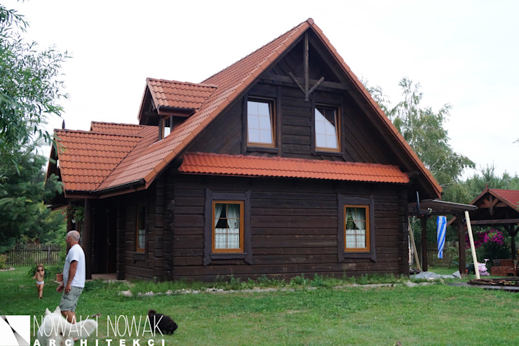Nowak i Nowak Architekci Country style house Wood