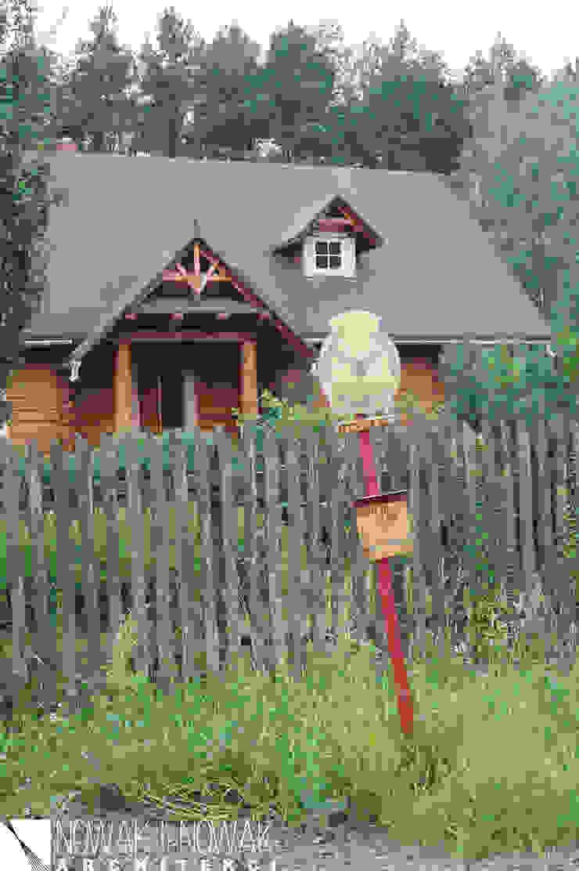 Casas de estilo rural de Nowak i Nowak Architekci Rural Madera Acabado en madera